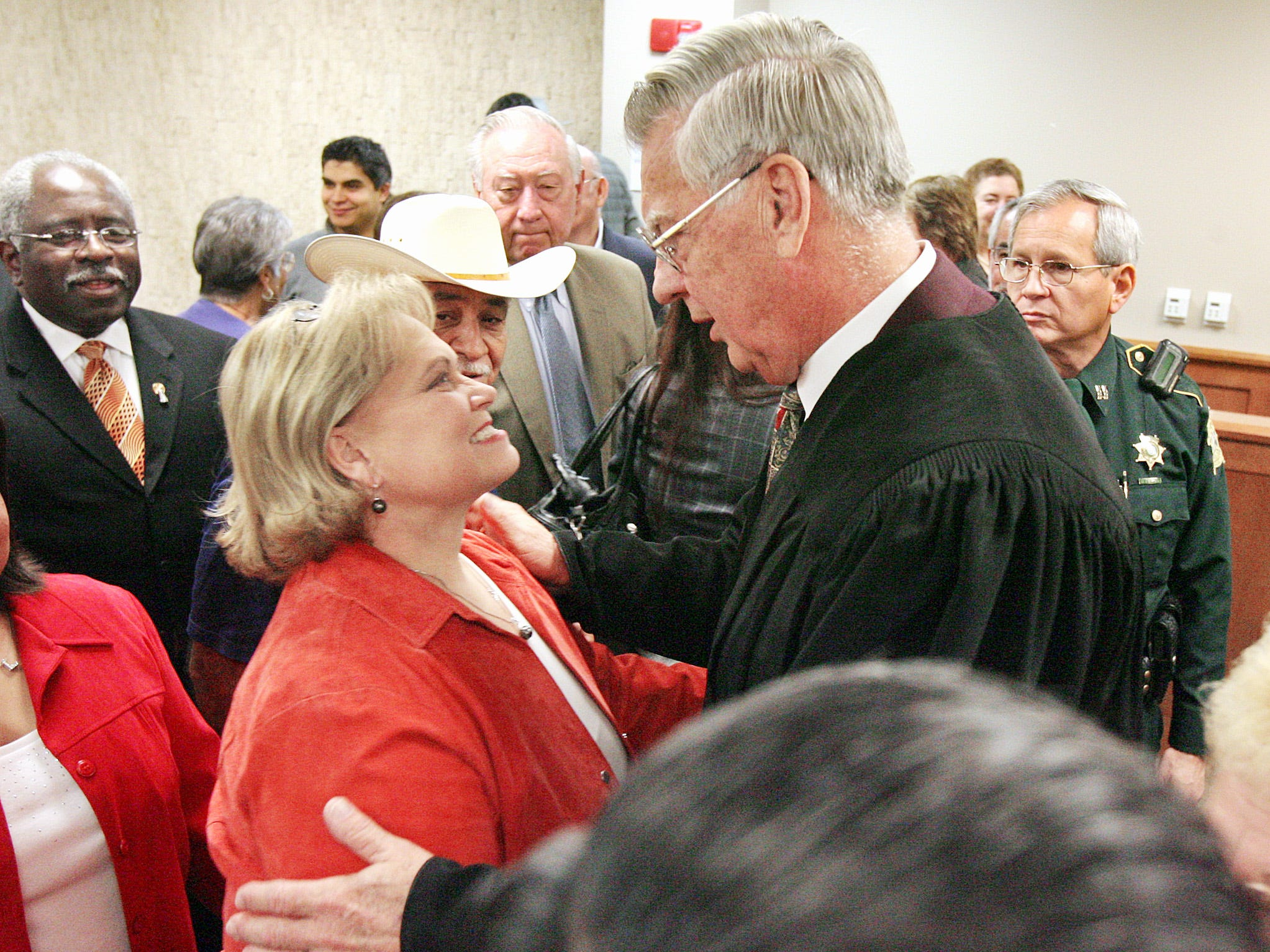 Newly sworn-in Nueces County Judge Loyd Neal talks with 117th District Court Judge Sandra Watts following the swearing in ceremony in 2006.