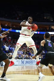 Texas Tech Red Raiders center Norense Odiase (32) grabs the ball in front of Buffalo Bulls forward Nick Perkins (33) and Bulls guard Davonta Jordan (4) during the second half in the second round of the 2019 NCAA Tournament at BOK Center.