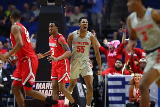 Mar 24, 2019; Tulsa, OK, USA; Houston Cougars forward Brison Gresham (55) celebrates behind Ohio State Buckeyes guard C.J. Jackson (3) during the first second in the second round of the 2019 NCAA Tournament at BOK Center. Mandatory Credit: Mark J. Rebilas-USA TODAY Sports