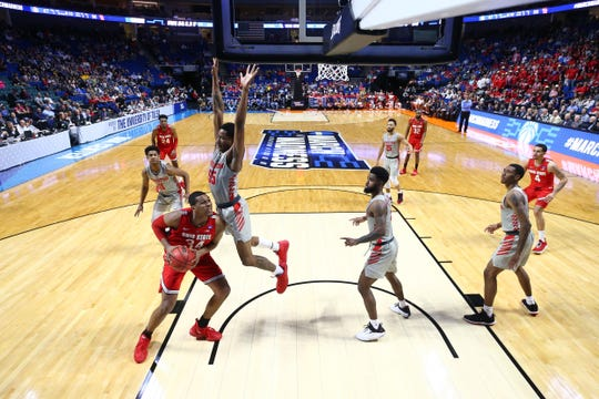 Mar 24, 2019; Tulsa, OK, USA; Ohio State Buckeyes forward Kaleb Wesson (34) controls the ball as Houston Cougars forward Brison Gresham (55) defends during the second half in the second round of the 2019 NCAA Tournament at BOK Center. Mandatory Credit: Mark J. Rebilas-USA TODAY Sports