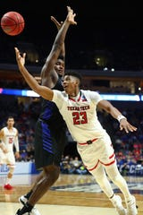 Mar 24, 2019; Tulsa, OK, USA; Texas Tech Red Raiders guard Jarrett Culver (23) shoots the ball past Buffalo Bulls forward Nick Perkins (33) during the second half in the second round of the 2019 NCAA Tournament at BOK Center. Mandatory Credit: Mark J. Rebilas-USA TODAY Sports