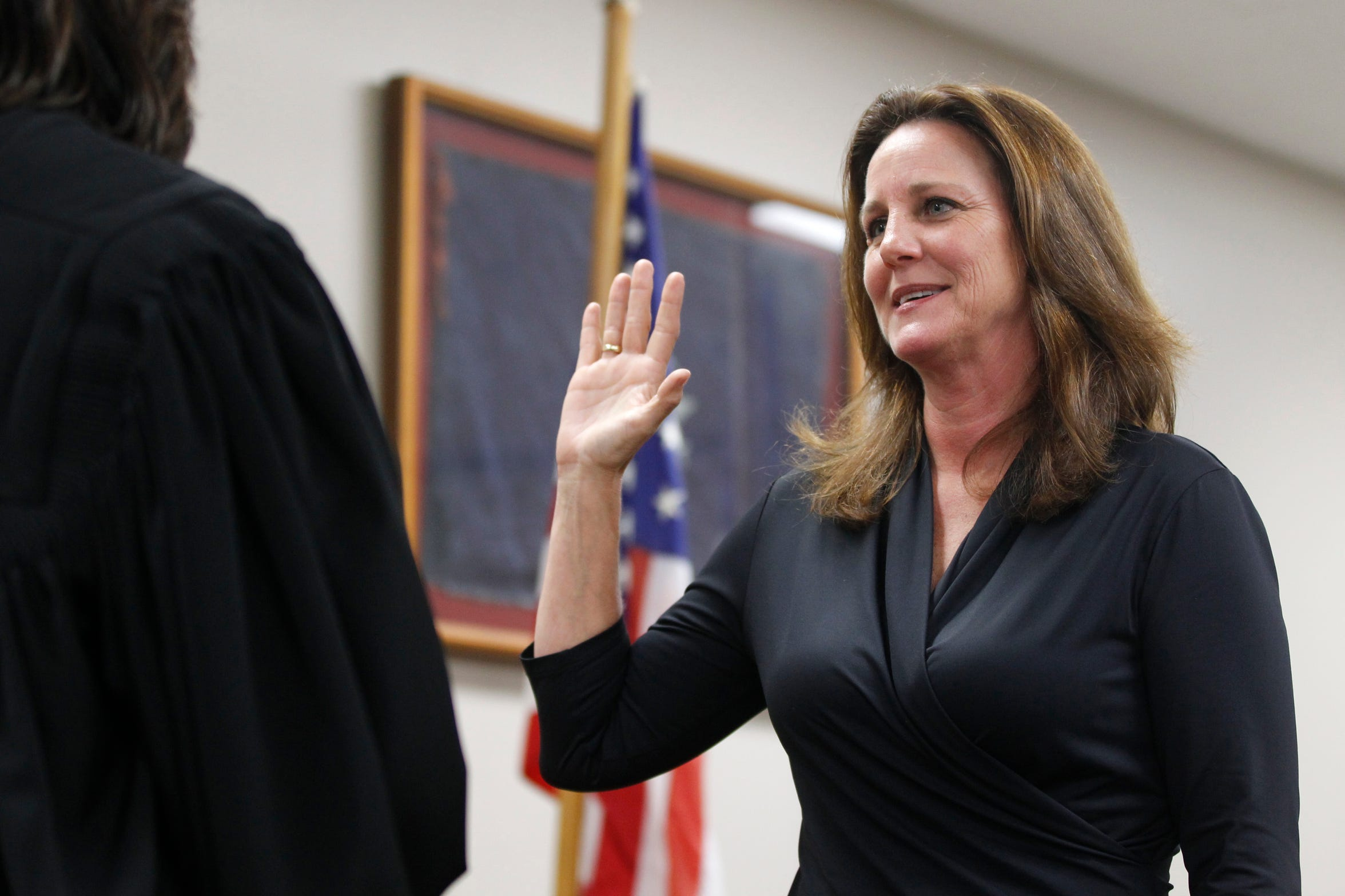 347th District Court Judge Missy Medary takes the judges oath of office in 2011. She is the first woman to serve as Presiding Judge of the Fifth Administrative Judicial Region.