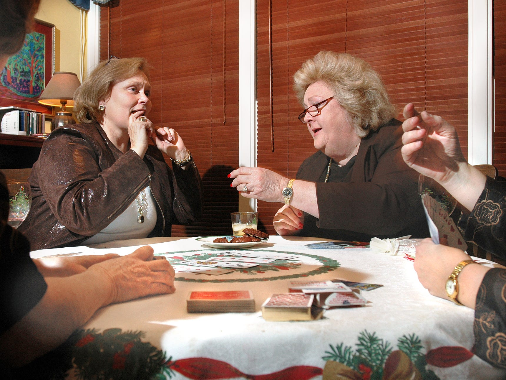 United States District Judge Janis Graham Jack (right) plays bridge with Judge Sandra Watts (left), 117th District Court, and others in 2005. Graham Jack was the first woman federal judge to serve in Texas south of San Antonio.