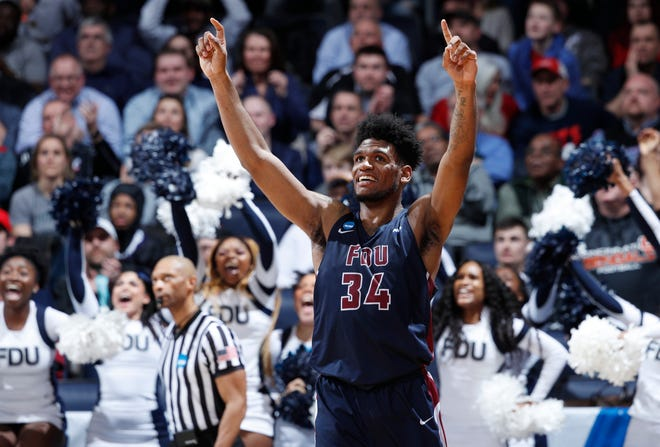 Fairleigh Dickinson senior Mike Holloway Jr. celebrates during a victory over Prairie View A&M during the NCAA Tournament on March 19. It was the program's first-ever tourney win.