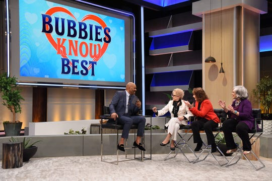 """Talk show host Steve Harvey chats with the co-hosts of a new match-making show in a segment to air Wednesday on """"STEVE."""" Former Cherry Hill resident Kathleen """"Bunny """" Gibson (right) is one of the three dating show hosts sitting with her co-hosts (from left) S. J.  Mendelson and Linda Rich."""