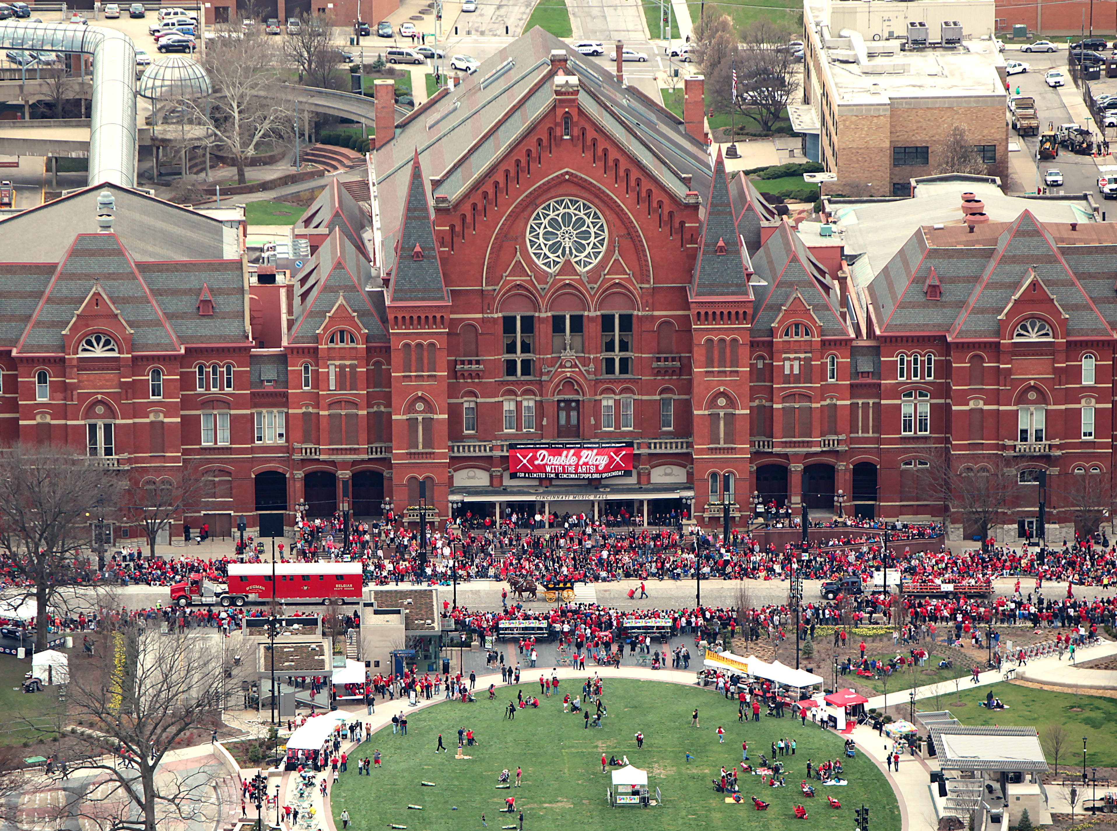 April 6, 2015: Crowds gather Monday in Washington Park near Music Hall for the Opening Day parade. The Enquirer/Cameron Knight