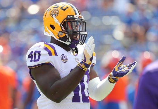 LSU Tigers linebacker Devin White (40) work out prior to the game at Ben Hill Griffin Stadium.