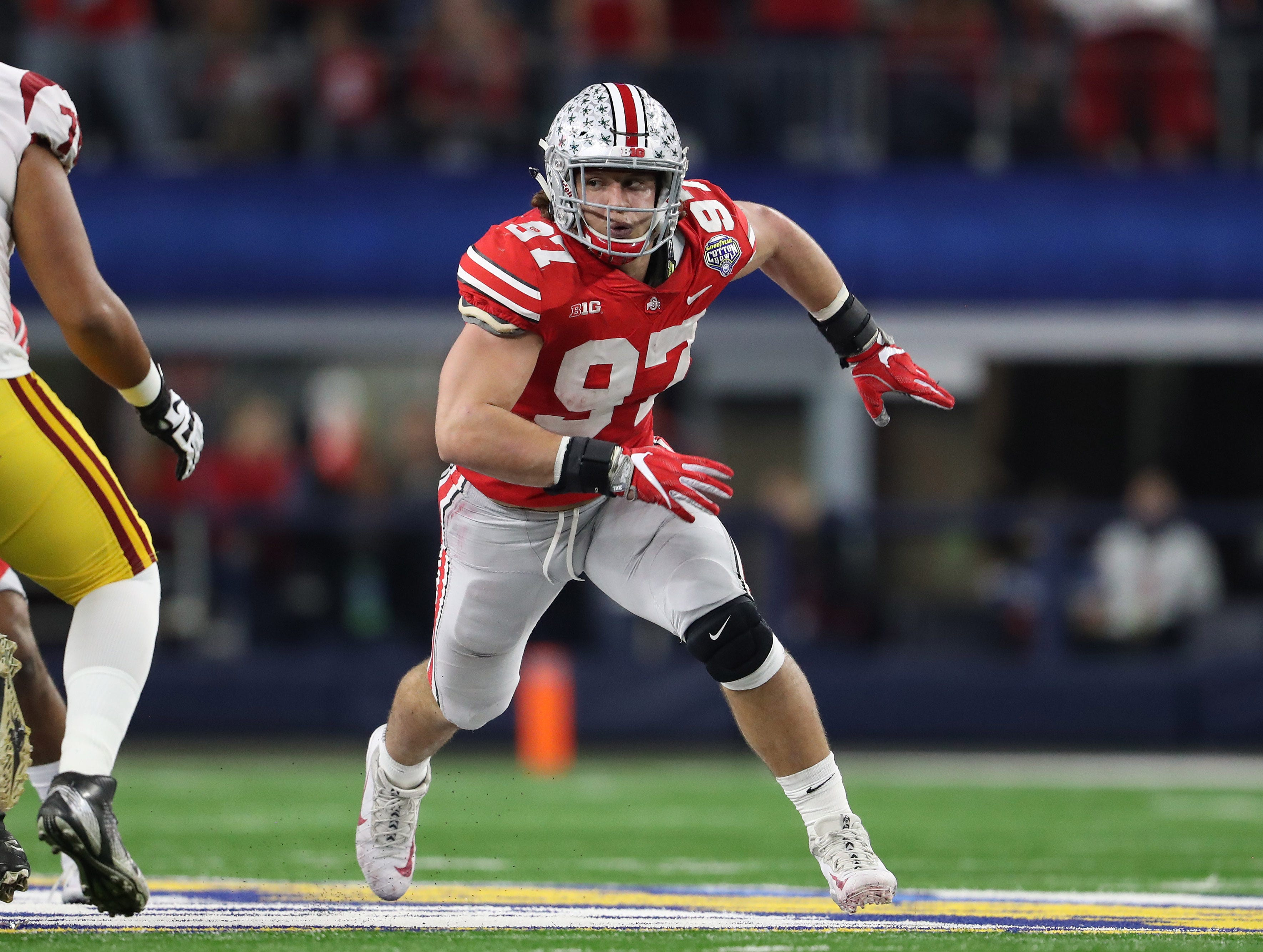 Ohio State Buckeyes defensive end Nick Bosa (97) rushes the passer against the Southern California Trojans in the 2017 Cotton Bowl at AT&T Stadium.