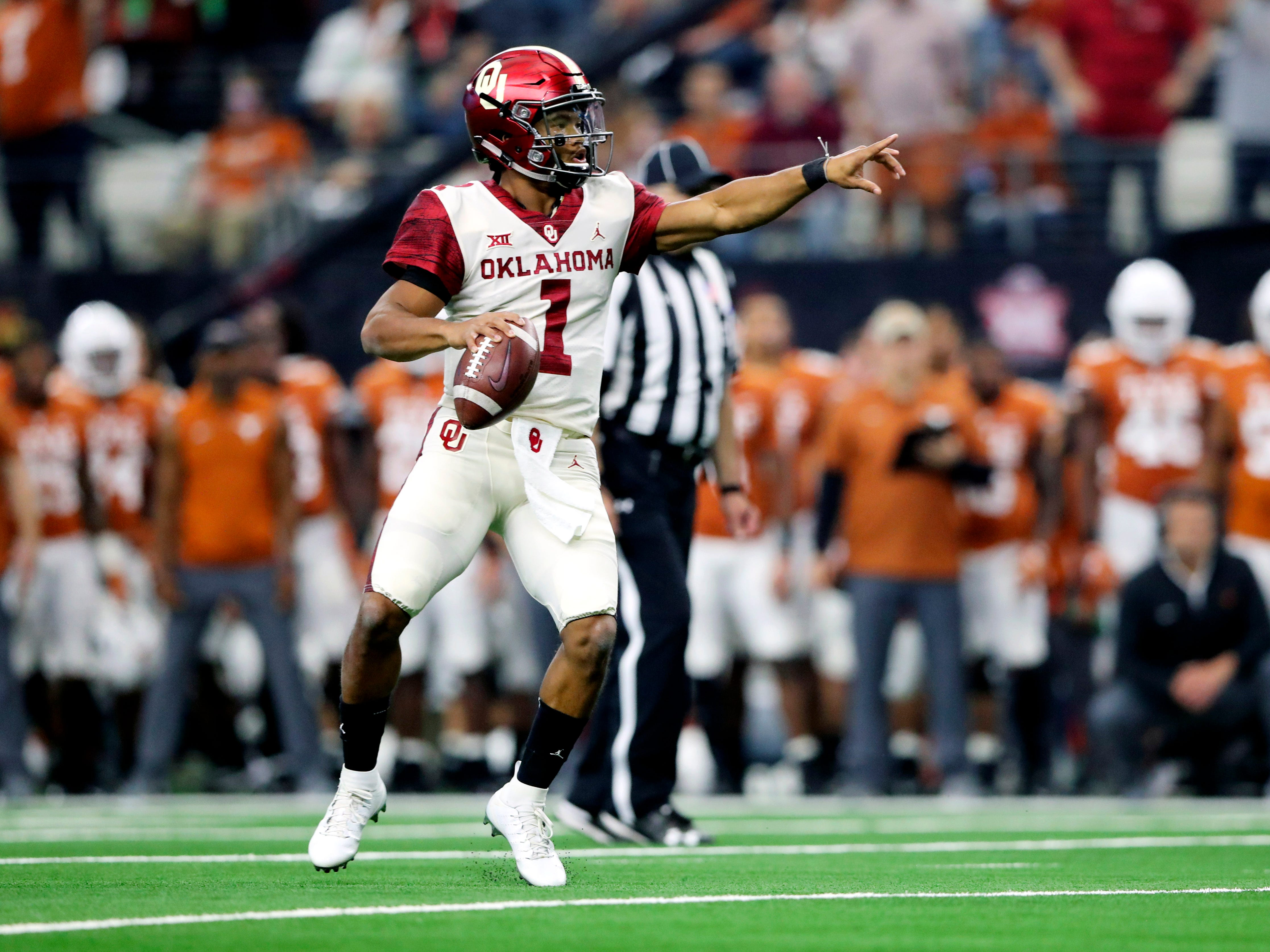 Oklahoma Sooners quarterback Kyler Murray (1) throws during the first quarter against the Texas Longhorns in the Big 12 Championship game at AT&T Stadium.