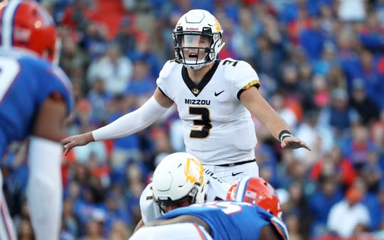 Missouri Tigers quarterback Drew Lock (3) calls a play during the second half at Ben Hill Griffin Stadium.