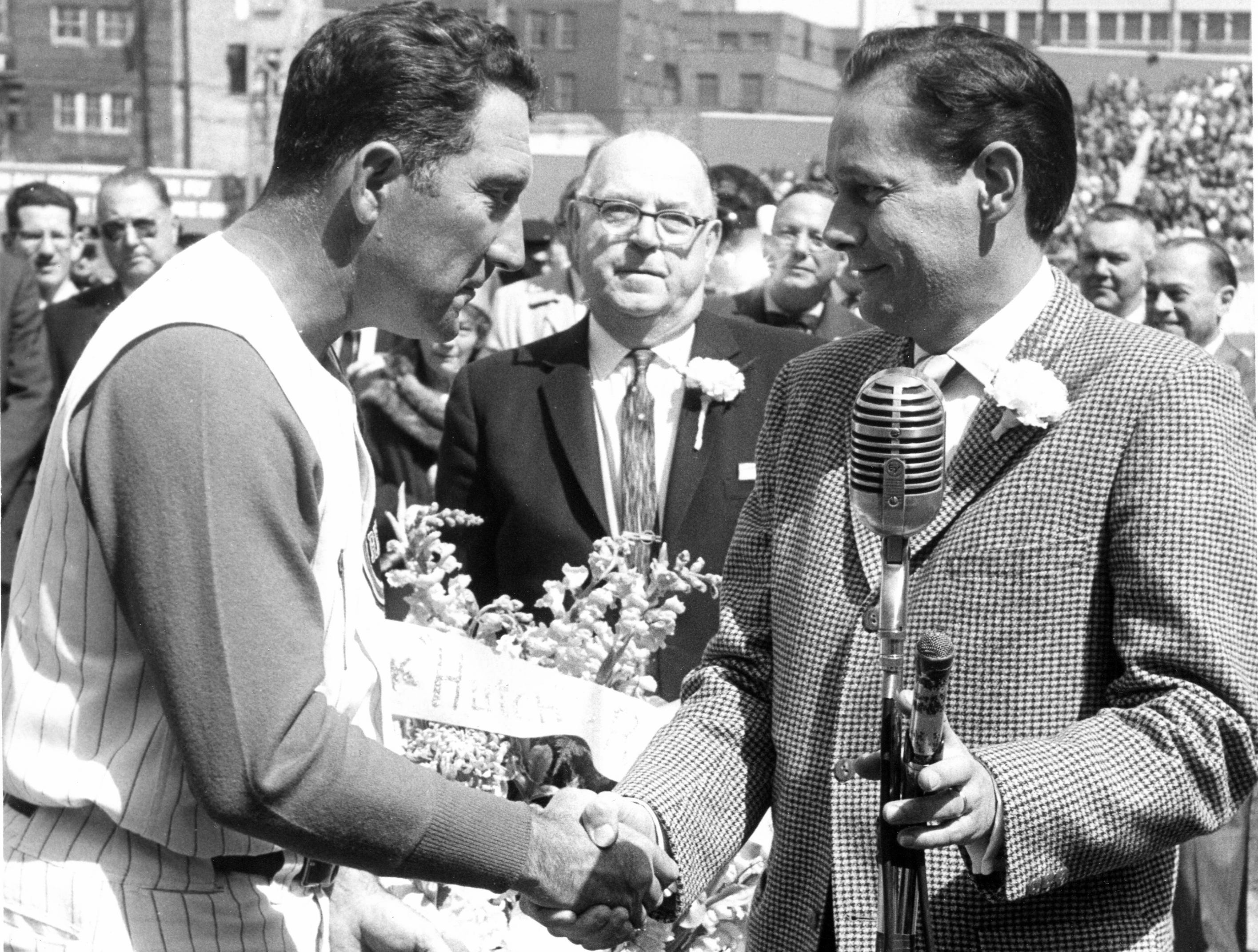 Former Reds manager Fred Hutchinson, left, during Frindlay Market Opening Day Parade in 1961.
