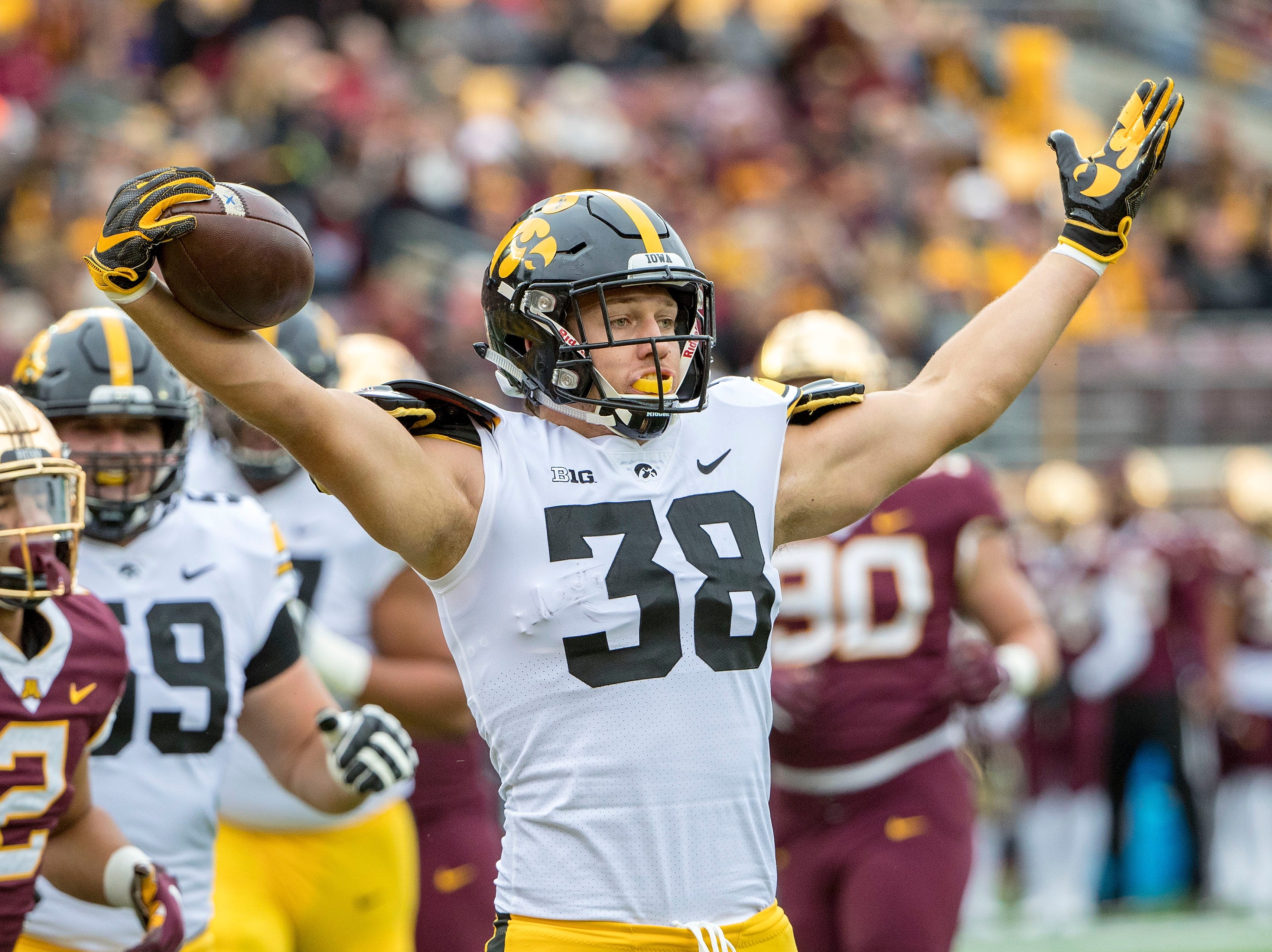Minneapolis, MN, USA; Iowa Hawkeyes tight end T.J. Hockenson (38) celebrates after scoring a touchdown against the Minnesota Golden Gophers in the first quarter at TCF Bank Stadium.