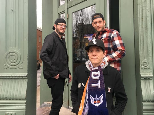 """FC Cincinnati fans outside rhinehaus bar in Over-the-Rhine. Kevin Pflanz, center, grew up with the Reds but says soccer is """"just more fun.''"""