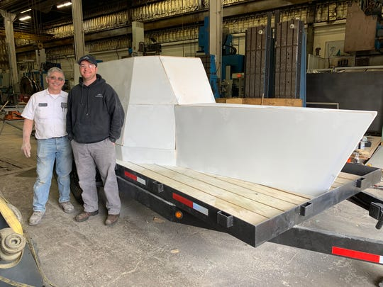General Tools Company employees Dave Gabbard and Pat Randall are volunteer parade float builders making a version of the ship for the upcoming Thursday, March 28 Findlay Market Opening Day Parade. General Tools, based in Cincinnati, paid for and built the float.