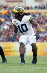 Michigan Wolverines linebacker Devin Bush (10) rushes during the second half of the 2018 Outback Bowl at Raymond James Stadium.