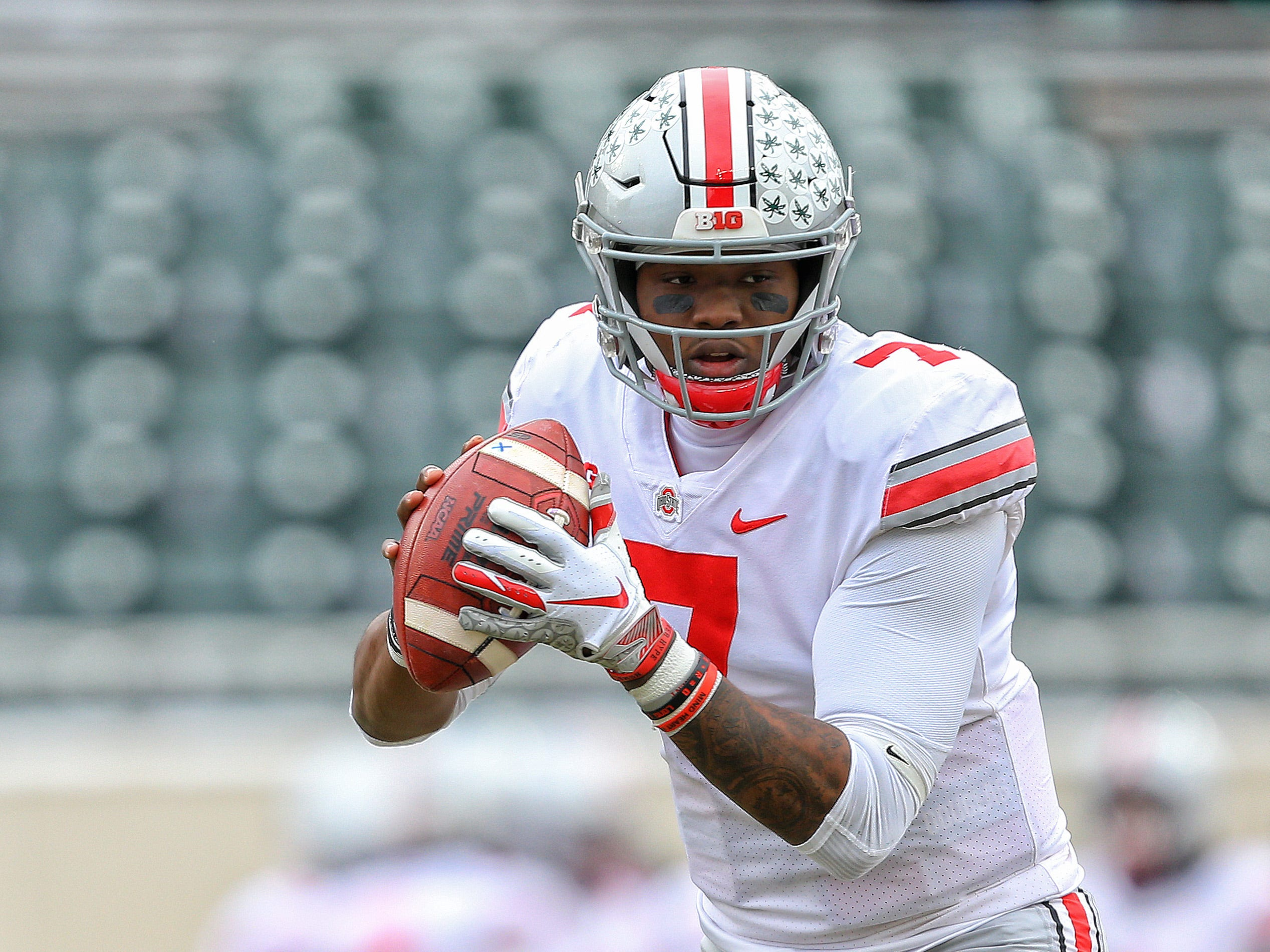 Ohio State Buckeyes quarterback Dwayne Haskins (7) warms up prior to a game against the Michigan State Spartans at Spartan Stadium.