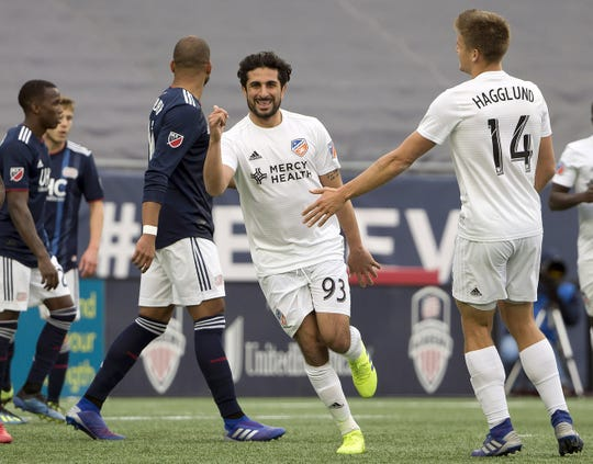 Mar 24, 2019; Foxborough, MA, USA; FC Cincinnati midfielder Kenny Saief (93) is congratulated after his goal by defender Nick Hagglund (14) during the second half of Cincinnati's 2-0 win over the New England Revolution at Gillette Stadium.