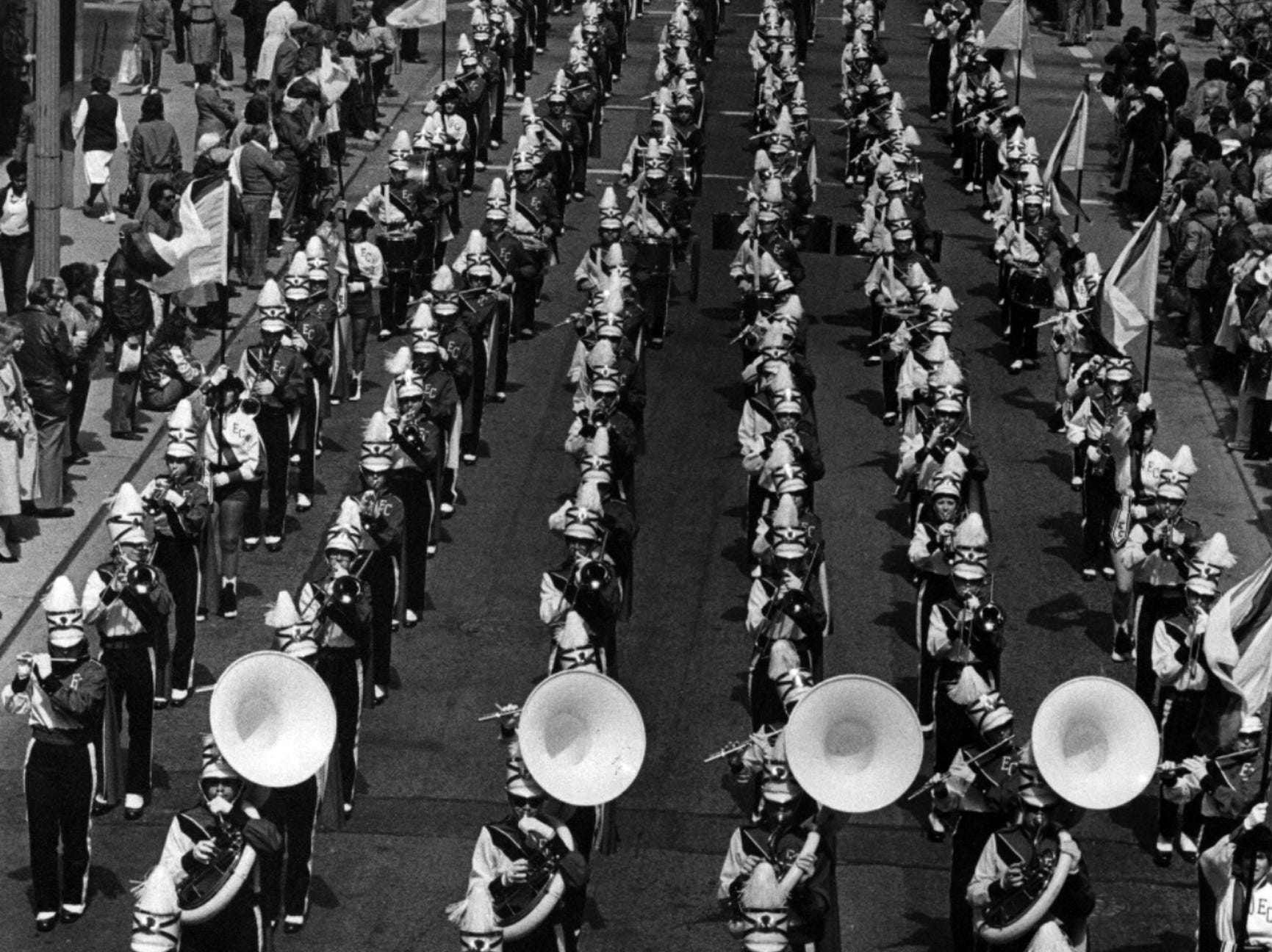 April 3, 1984: No rain fell on the annual Opening Day Parade from Findlay Market to Riverfront Stadium, Under beautiful skies, the East Central High School band of Indiana belts out a tune on Race Street. Later, the Reds belted out an 8-1 victory over the visiting New York Mets.