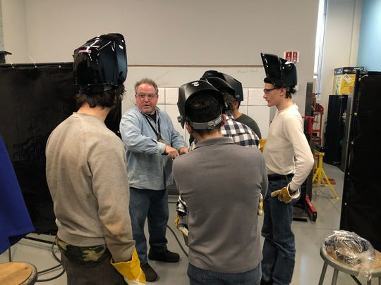 Instructor Michael Hart talks with students in an American Welding Society MIG welding class at Raritan Valley Community College in Branchburg.