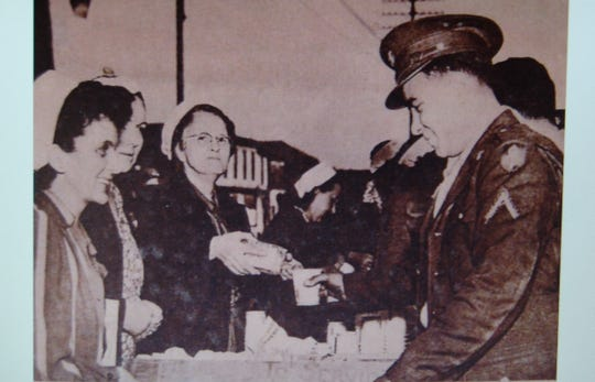 A photo of women serving military men during World War II at the Dennison Canteen, which is now a museum devoted to the canteen and World War II. It was the subject of an award-winning documentary by home school student Annalissa Hankinson of Walhonding.
