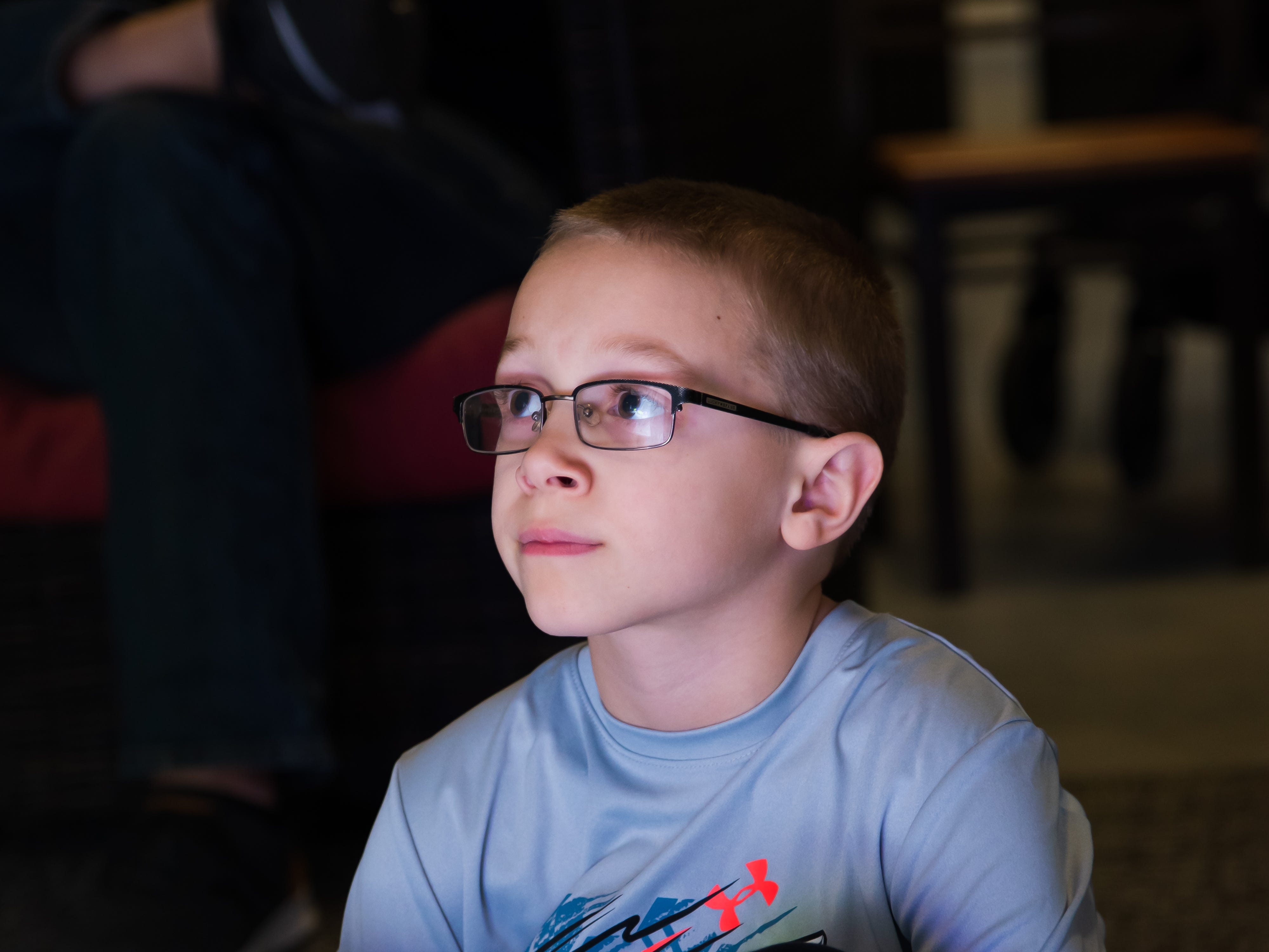 Parker Mundell, 7, of Altoona watches an experiment Wednesday, March 20, 2019, during a Science Center program at the Outlets of Des Moines in Altoona.