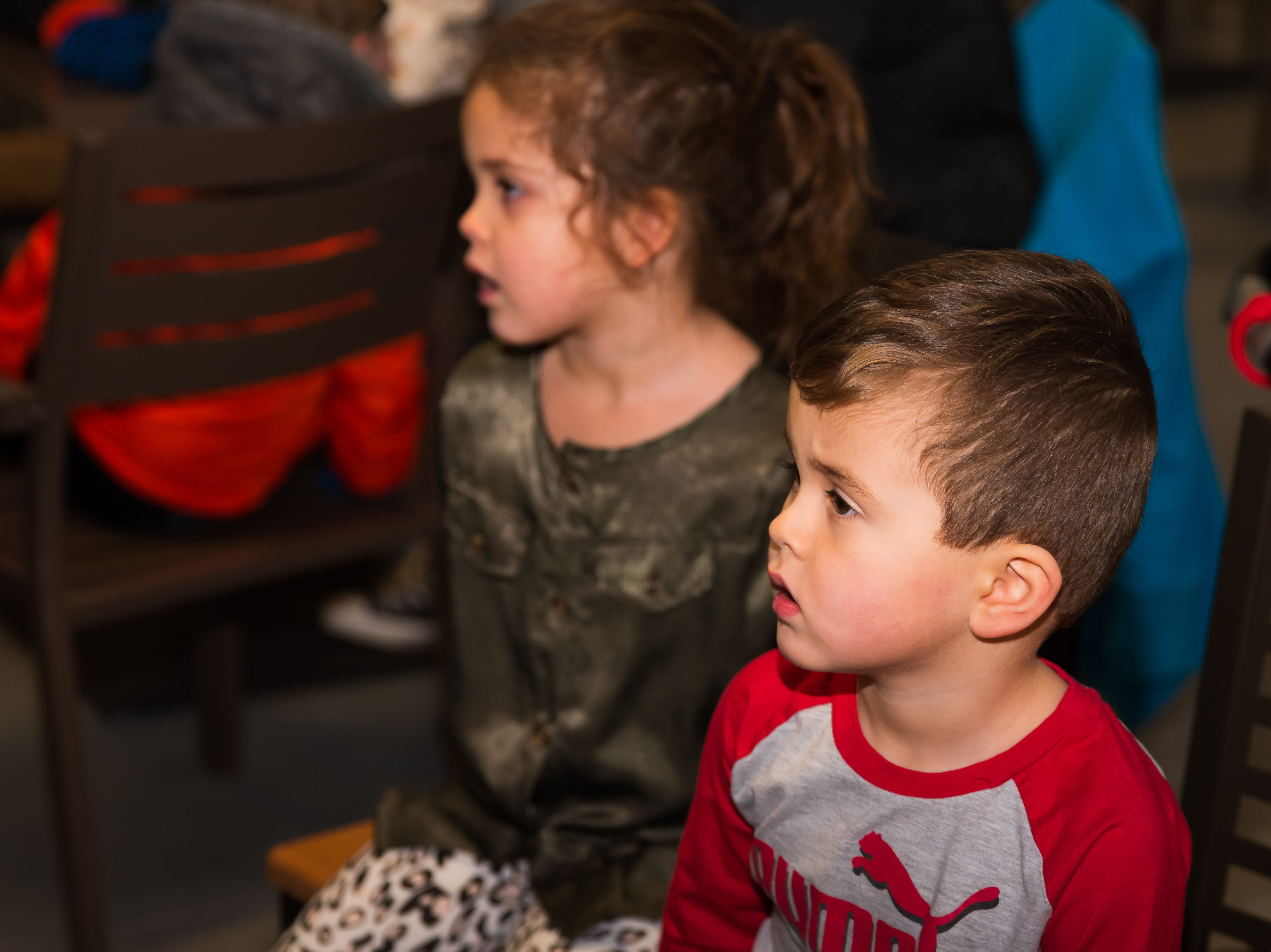 Louden, 3, and Anora Stout, 4, both of Altoona, watch the experiments Wednesday, March 20, 2019, during a Science Center program at the Outlets of Des Moines in Altoona.