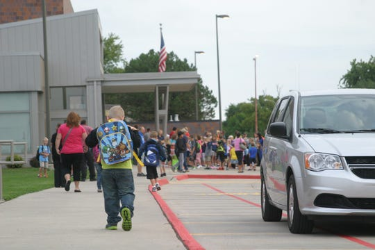Anderson Elementary School students arrive for the first day of school in 2012.