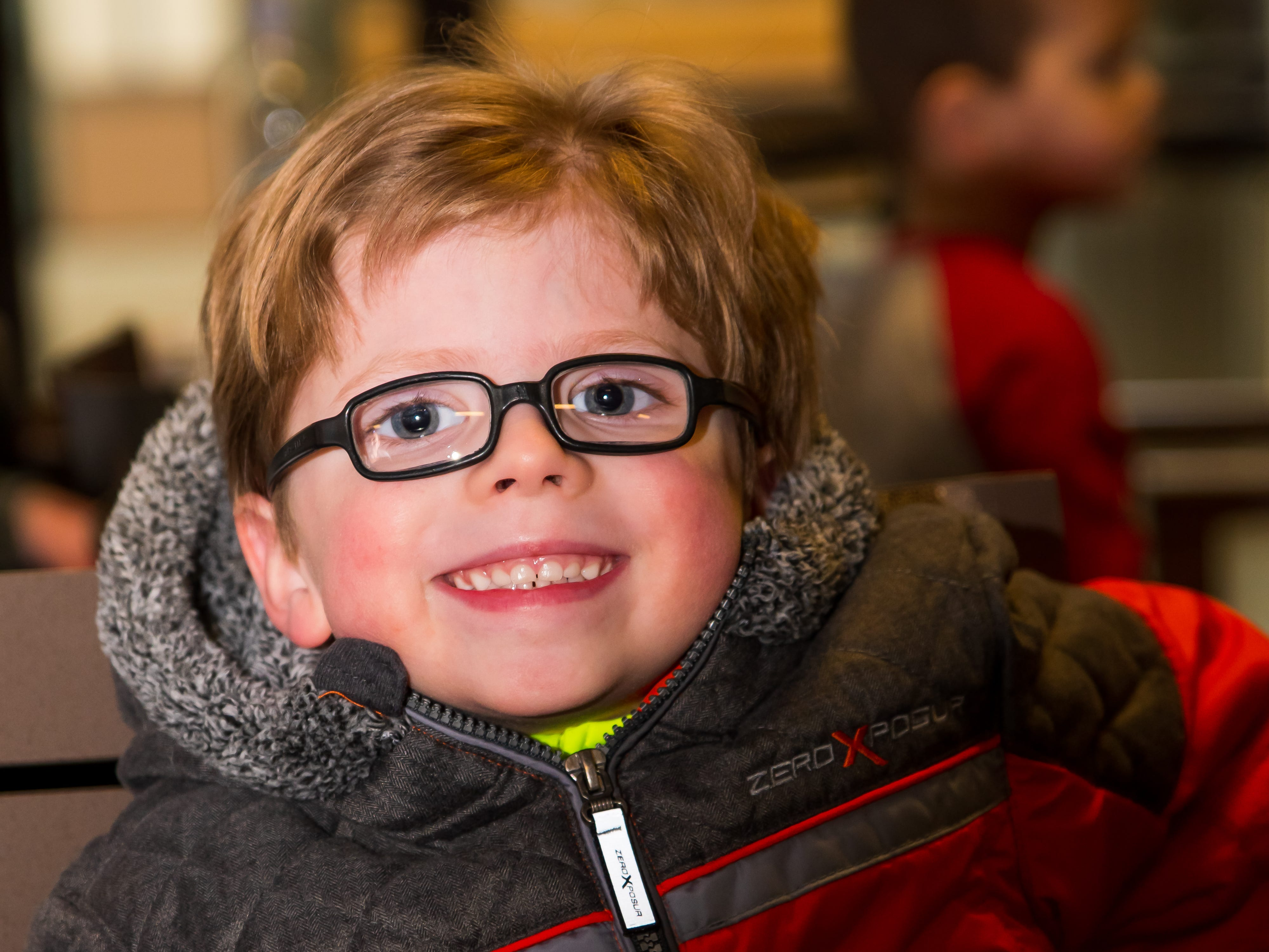 Barrett Herteen, 4, of Altoona is all smiles Wednesday, March 20, 2019, during a Science Center program at the Outlets of Des Moines in Altoona.