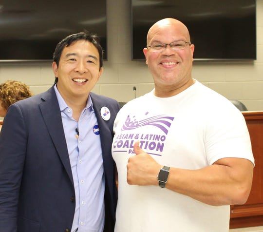 Presidential candidate Andrew Yang poses with Iowa third congressional Democratic chairman Al Womble. Yang has named Womble his Iowa campaign chair.