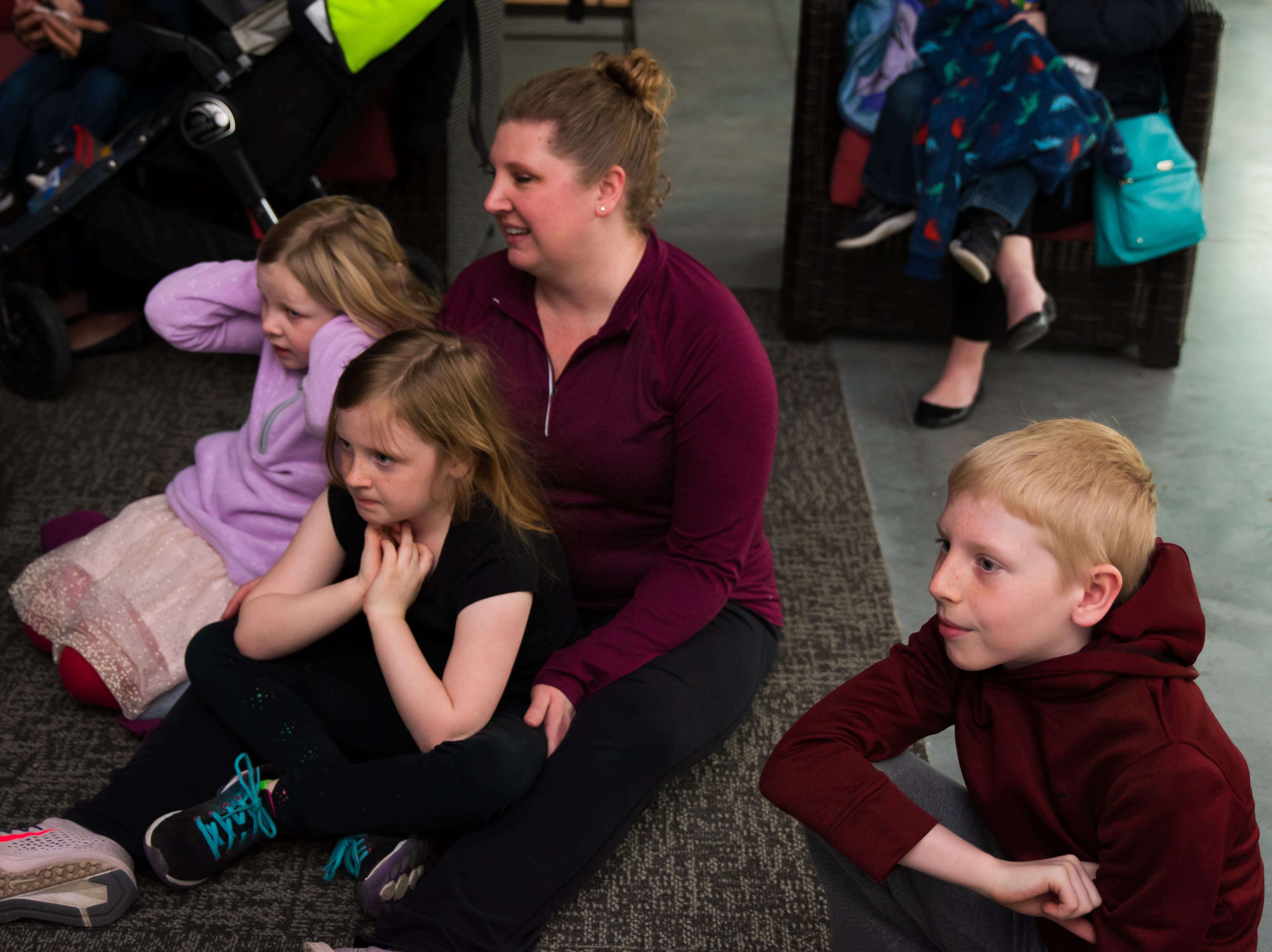 Jessica, Ayla, 7, Hadley 5, and Parker Low, 10, all of Ankeny, watch an experiment Wednesday, March 20, 2019, during a Science Center program at the Outlets of Des Moines in Altoona.