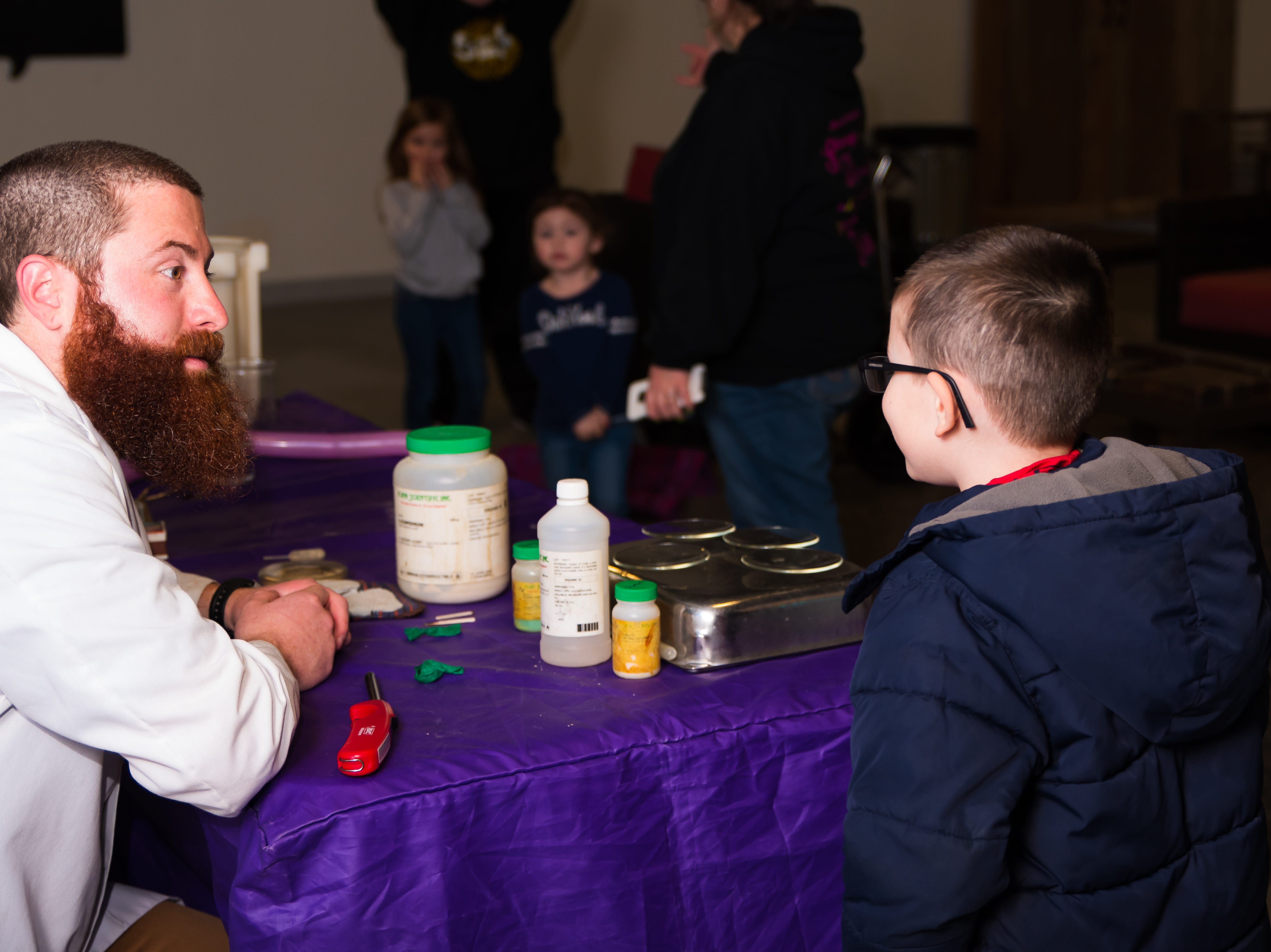 Bennett Mundell, 5, of Altoona thanks Mark Runkel from the Science Center on Wednesday, March 20, 2019, after watching the mad scientist perform experiments at the Outlets of Des Moines in Altoona.