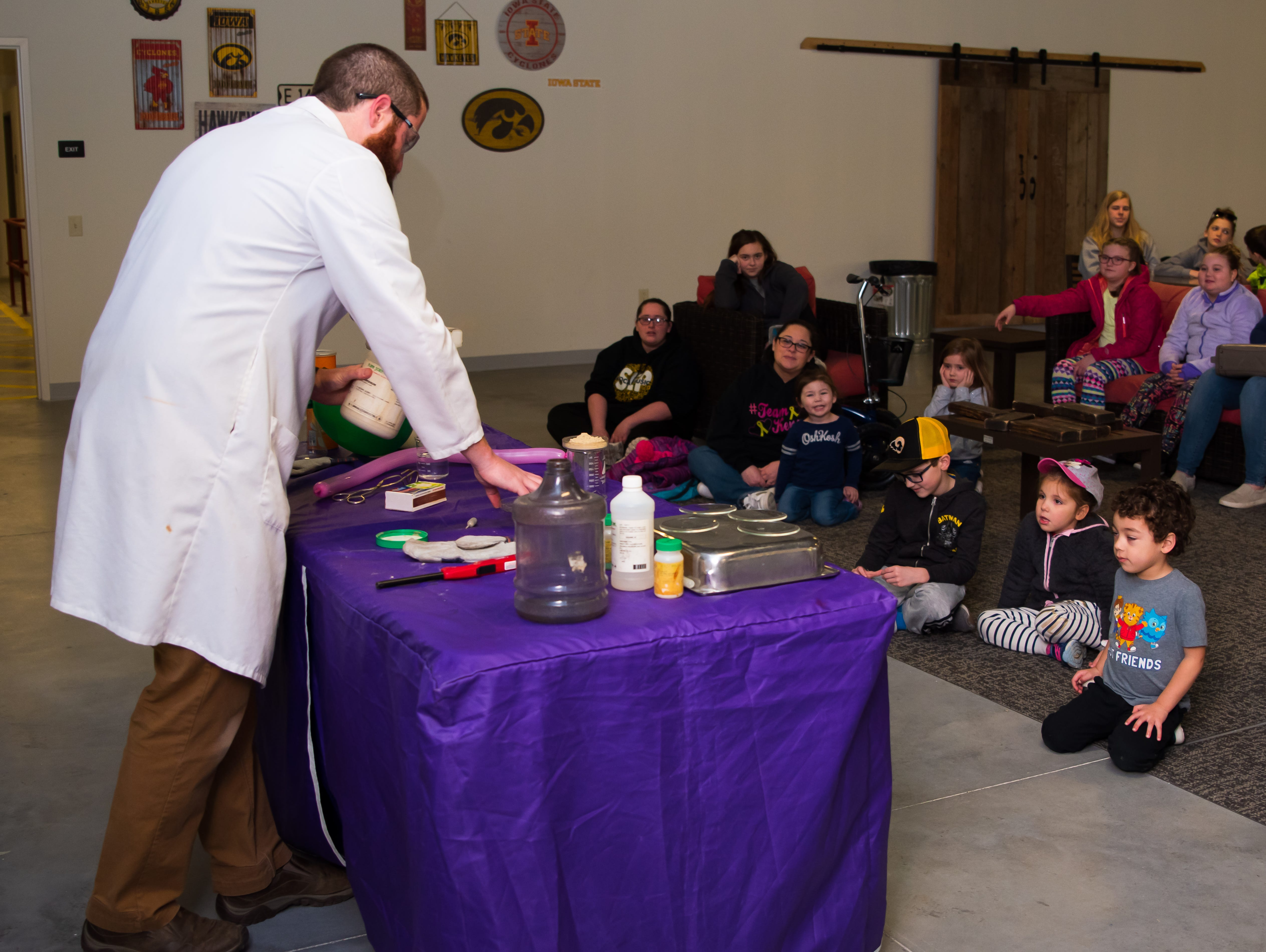 Science Center outreach coordinator Mark Runkel demonstrates an experiment Wednesday, March 20, 2019, during a Science Center program at the Outlets of Des Moines in Altoona.