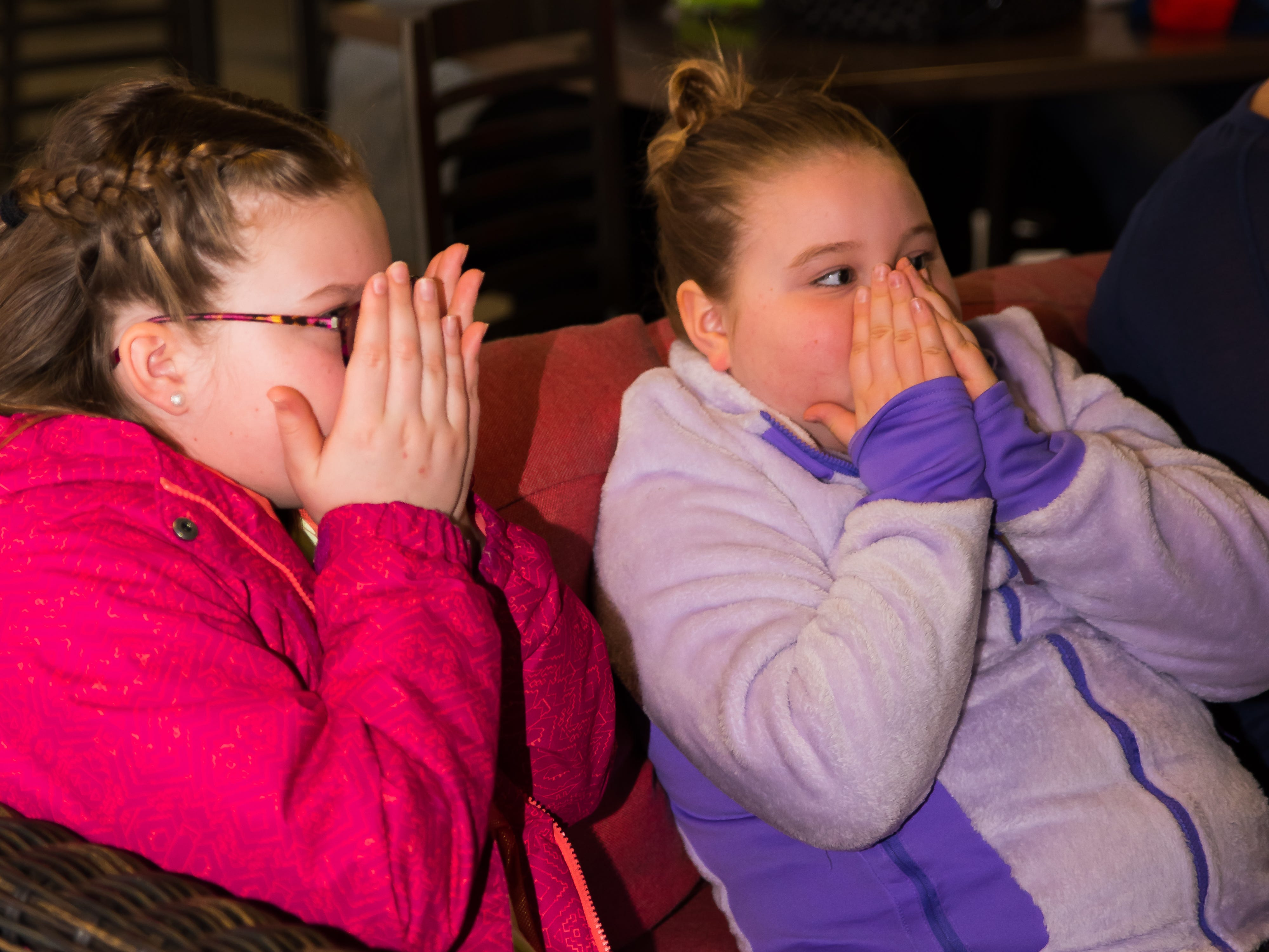 Ryen, 11, and Brinley McRoberts, 8, both of Altoona, participate in the experiments Wednesday, March 20, 2019, during a Science Center program at the Outlets of Des Moines in Altoona.