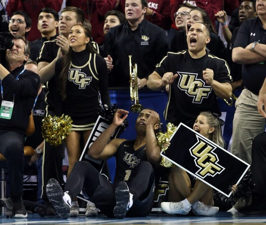 UCF guard B.J. Taylor (1) reacts after being defeated by Duke on Sunday.