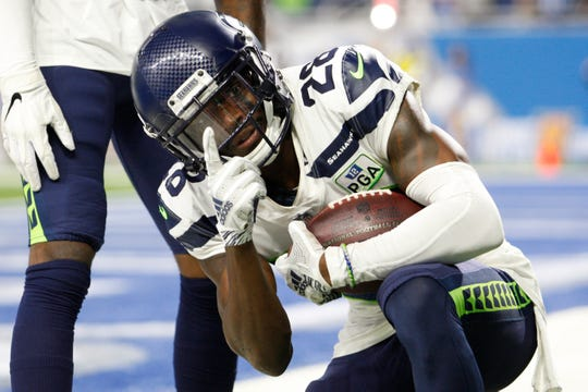 Seattle Seahawks cornerback Justin Coleman celebrates his interception in the fourth quarter against the Detroit Lions at Ford Field, Oct. 28, 2018.