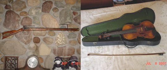 A rifle replica and antique violin stolen from a log cabin that's a part of a historical village in Chesterfield Twp.