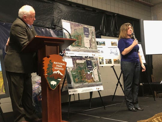 Toni Cooper, right, executive director of the River Raisin National Battlefield Park Foundation, reveals the upcoming plans for development of the River Raisin National Battlefield Park,as part of the Heritage Corridor investment as Chief Ted Roll, left, of the Wyandot of Anderdon Nation listens March 21, 2019 in Monroe, Mich.