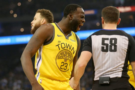 Golden State Warriors forward Draymond Green reacts after being called for a foul against the Detroit Pistons in the first quarter at Oracle Arena, March 24, 2019.