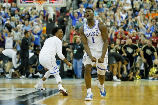 Zion Williamson celebrates Duke's one-point win over UCF on Sunday in the second round of the NCAA tournament.