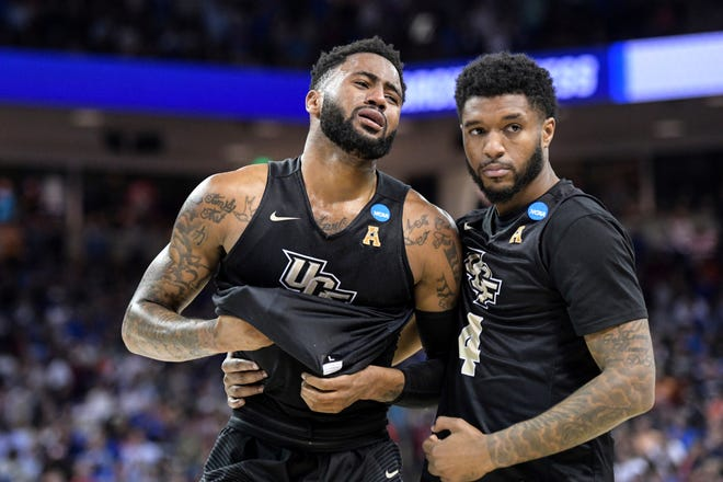 Central Florida's Dayon Griffin, left, and Ceasar DeJesus agonize over the loss to Duke.