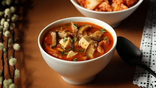 Pork and Red Chili Kimchi Stew, re-created from a favorite Korean restaurant, is built on the spicy and sweet/tart flavors of the pickled vegetable staple plus gochujang (red chile paste) and gochugaru (red chili flakes).