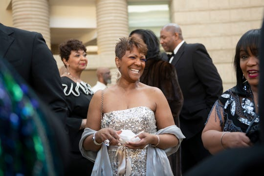 """Sabrina Owens, niece of Aretha Franklin, enjoys herself at a reception before the premiere of the Aretha Franklin concert film """"Amazing Grace"""" at the Charles H. Wright Museum of African American History in Detroit, Monday evening."""