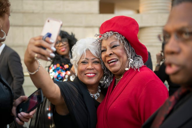 """Beverly Banthom, of Detroit, left, takes a selfie with singer Martha Reeves during a pre-reception for the premiere of the Aretha Franklin concert film """"Amazing Grace"""" at the Charles H. Wright Museum of African American History in Detroit, Monday evening."""