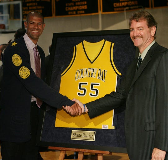 Former Detroit Country Day basketball star Shane Battier shakes hands with Kurt Keener in 2007 during a ceremony to retire Battier's jersey.