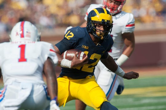 Running back Chris Evans will not play for Michigan this season, head coach Jim Harbaugh confirmed Sunday.