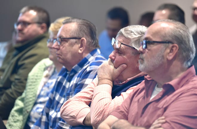 Retired state Sen. Mike Green, second from right, of Mayville, listens intently with others during the Tuscola County Board of Commissioners Special Meeting in Caro on March 19.