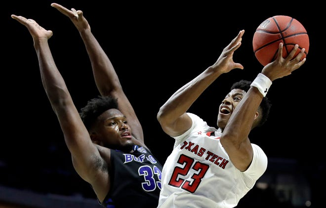 Texas Tech's Jarrett Culver (23) shoots past Buffalo's Nick Perkins (33) during the second half Sunday. Texas Tech won 78-58, setting up a meeting with Michigan in the Round of 16 on Thursday.