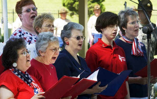 Common Time Choral Group members sing the National Anthem during a 2007 Memorial Day Service at Woodlawn National Cemetery in Elmira.