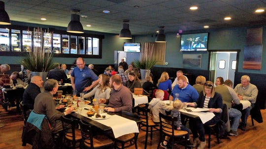 David Parker, standing, left, developed Prime Time Pub & Grill to be an upscale sports bar and a casual spot for fine food.