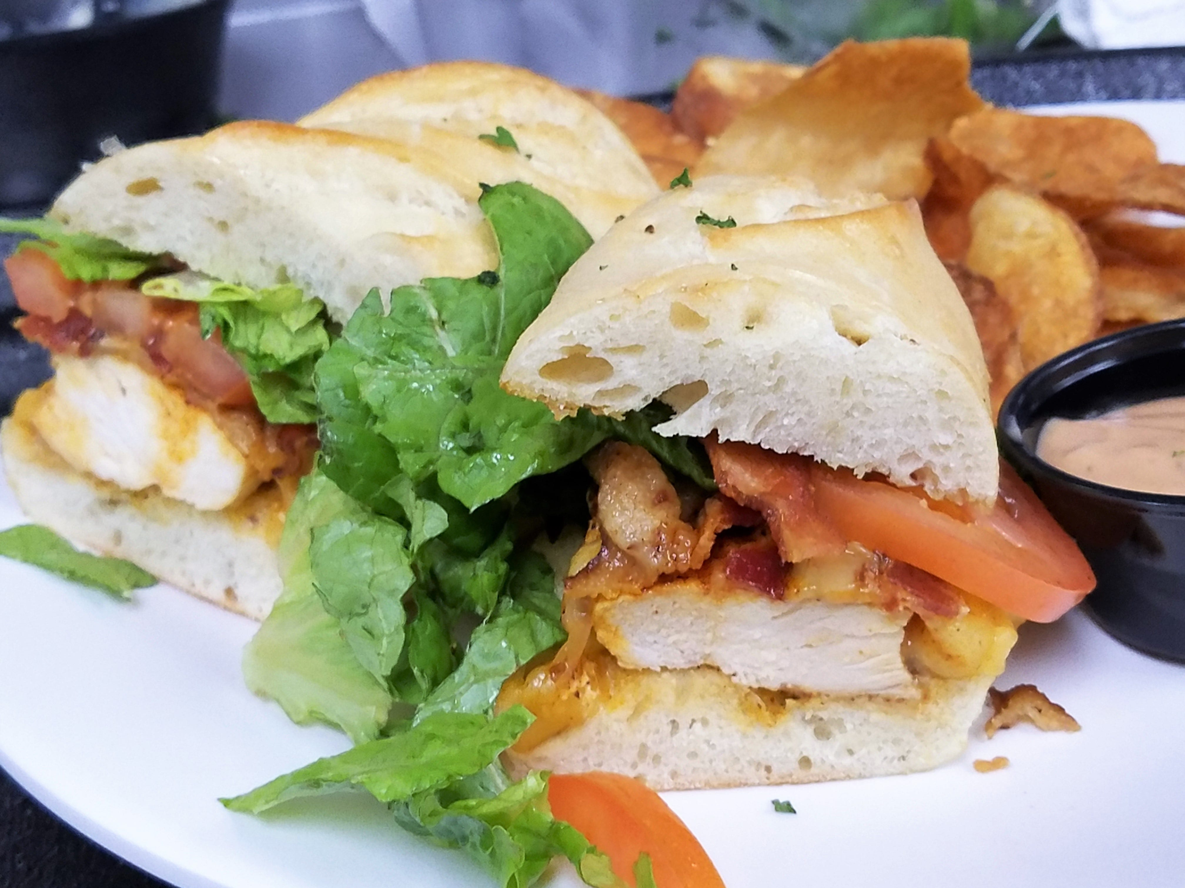 The Chicken sandwich with blackened chicken, bacon, smoked Gouda cheese, tomato and romaine at Prime Time Pub & Grill.